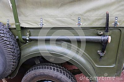Off road jeep - details of pickaxe on side over tire.