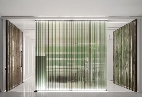 Stripy Glass Screens Obscure Views Between Rooms At A