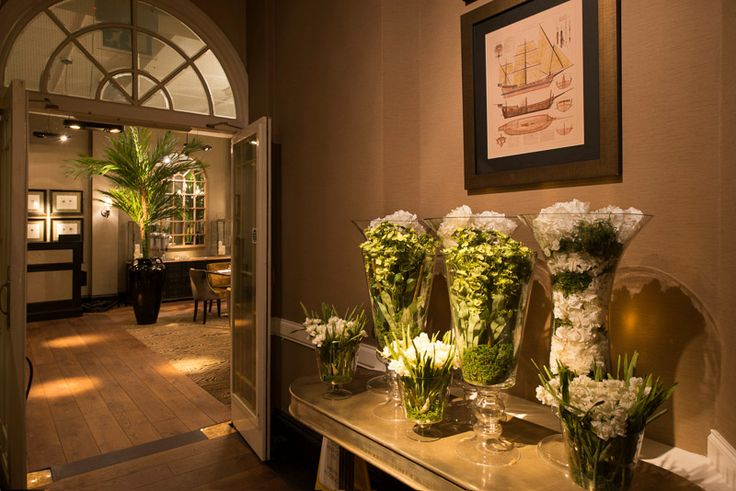 Silk flowers arranged in glass vases create an unusual and timeless feature.