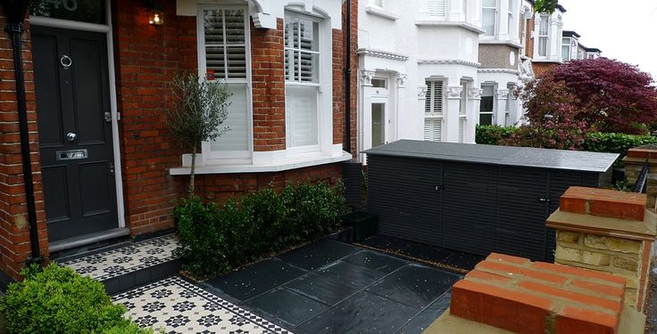 brick wall slate paving mosaic tile path bin store bike store victorian porch tile london