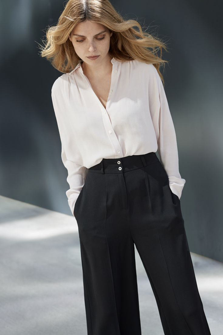 Work your look this fall Always a stylish choice: black trousers and a white top. Shirt FILIPPA K. Trousers MARIMEKKO. Read more on how to update your office look from stockmann.com/inspiroidu #stockmann #inspiroidu