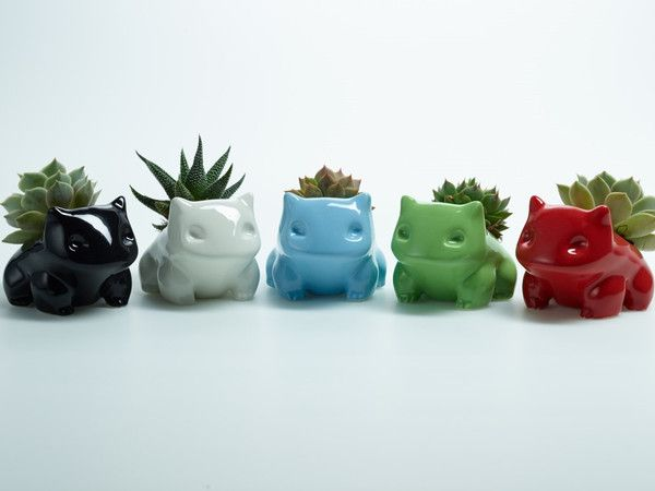 FOR LANEY!  Ceramic monsters have a nice heft with a smooth, shiny shell. The planters do NOT come with a plant. Each one is wrapped with plenty of bubble wrap in a super sturdy box. Also included is a pipette to