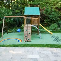 Wow, this is such a fun little play area to have in a small yard. I like that there is a spray pad surface underneath the play set. If I was a mother, I would want to know that if my child fell off of this that they would have a soft landing. So, having something like that under it would give me peace of mind and it seems like it would be fun for the kids as well.