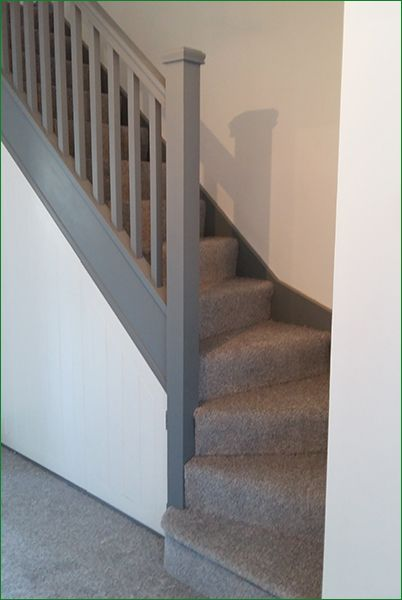 Oliver Staircase - single winder stairs with square spindles, newel posts and newel caps in softwood which the customer has painted grey making a striking feature of them.