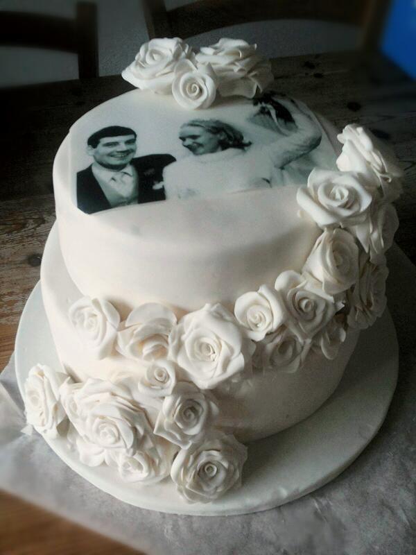 Fondant wedding cake with roses.