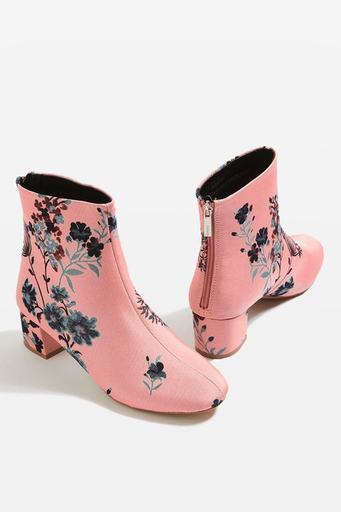 Commit to floral this season in the blooming pink floral ankle boots. This eye-catching pair is perfect for adding a statement touch to your spring looks.
