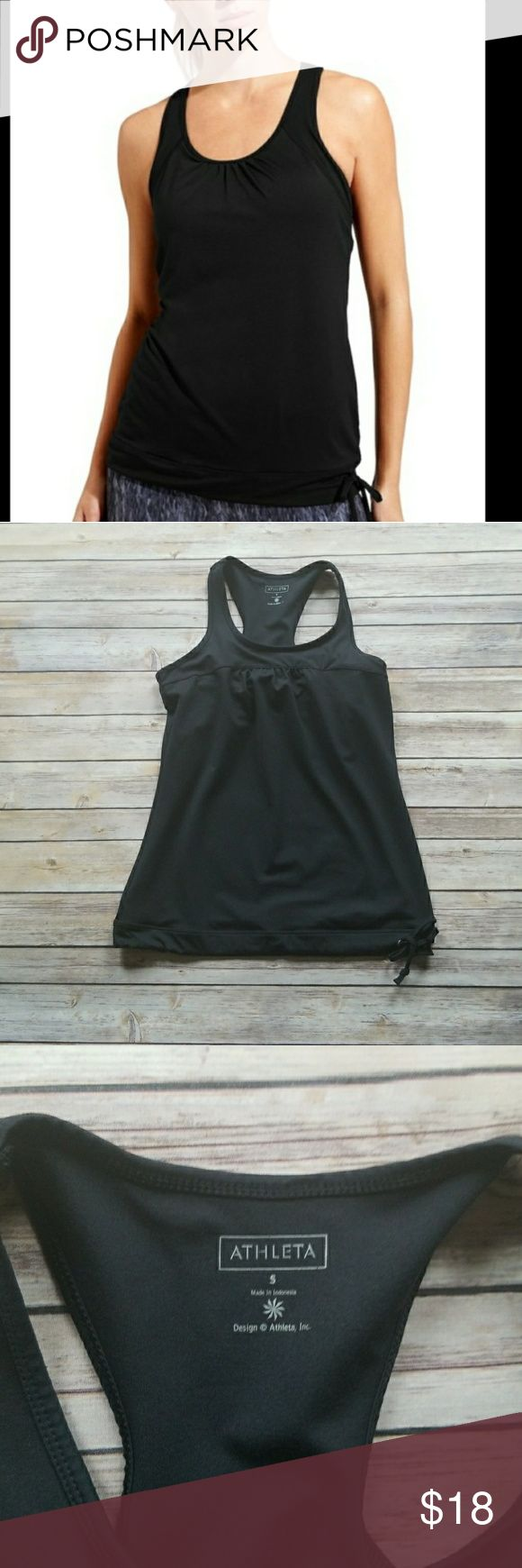Athleta Black Razorback Tinker Tank Athleta Black Razorback Tinker Tank  *Black, razorback tank *Looser fit *Built in, breathable mesh bra support *Throw on and go sport in apparel *Great for gym/training, run, and studio workouts *Loose middle doubles as body camouflage *Banded hem *88% Polyester, 12% Lycra. Bra: 93% Polyester, 7% Spandex *Size Small *Excellent pre-owned condition. No rips, holes, stains or pulls Athleta Tops Tank Tops #runningapparel
