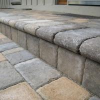 Bullnose treads add a graceful look to hardscape stairs.  add pavers over the top of the existing front step!