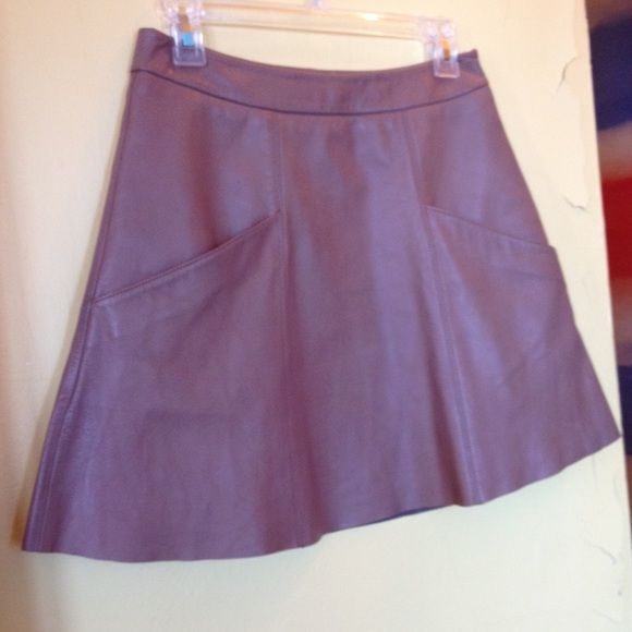 """Joie """"Maisel"""" Leather SkirtNEW Lambskin leather that is buttery soft. Styled with a raw hem. Two slit front pockets, side zip closure, fully lined. 100% Leather. Has a tiny pen mark near the top right pocket (see 2nd pic). Low price already reflects the imperfection. Retailed for $498 at Nordstrom. Last two pics are stock photos to show fit. Actual color is """"deep frappe"""" (mocha color). Waist 14"""" /Length 16.5"""". This skirt is very beautiful  Sold out in this unique color ! Joie Skirts Mini"""