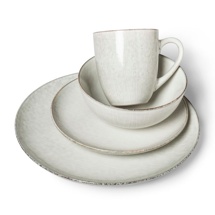 If you're just starting out on your own, or it's time to overhaul your current dinnerware, the 16-piece Solene Round Stoneware Dinnerware Set from Project 62™ is a mature option. A handmade effect is achieved with imperfect glazing and variance in lines and colors, but simple silhouettes keep these as everyday dishes. Whether this is the first set you buy or a replacement, this dinnerware is neutral and textured enough to complement any style.<br><br>1962 was a bi...