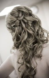 I think that this is a waterfall or French braid, with lots of curls. Lots.