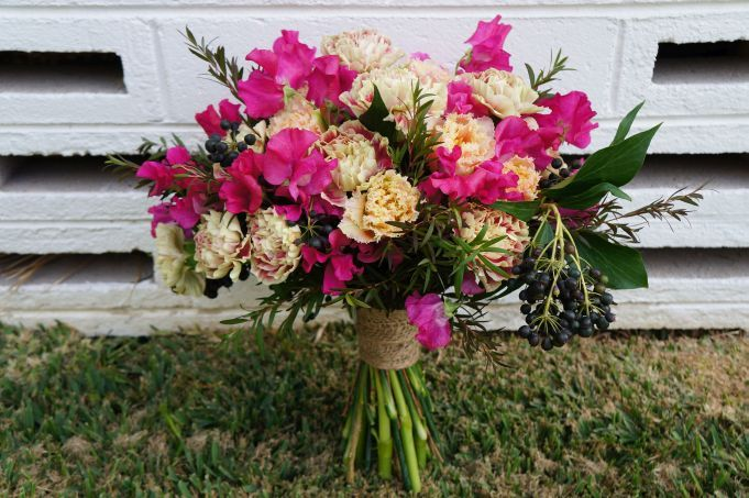 Wild pink! Carnations, Sweet peas and berries.