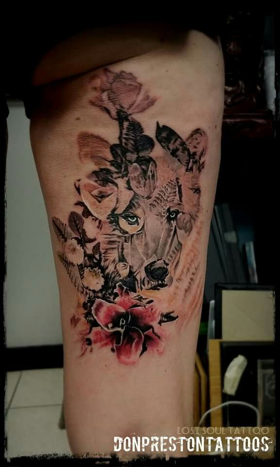 Tattoo by Don Preston at Lost Soul Tattoo And Piercing in Spring City, PA wolf tattoo flowers girly tatt leg watercolor x-ray flower digital image reference urban outfitters t-shirt