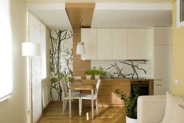 kleines-wohnzimmer mit offener küche holz creme kombination fototapete zweige glasplatte