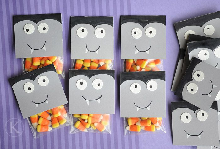 Just fold 2 squares of a grey paint swatch (free @ places that sell paint) and use a sharpie to draw face & hair.  Use white circular stickers for eyes.  Pretty simple, huh?