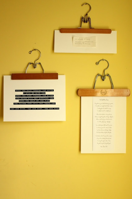 What a simple, great decorating idea! Vintage hangars, verses, poems, and quotes that inspire you, and stapled paper. I love it.