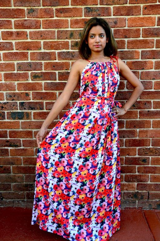 Bold yet pretty, overall floral print maxi dress! It comes in Free size which would fit from sizes Small to XXL. Order now from www.axori.com.au