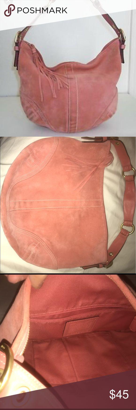 Pink coral Coach shoulder bag Medium sized shoulder bag with tassel. Zipper with interior side pocket. Worn once. Excellent condition. Coach Bags Shoulder Bags