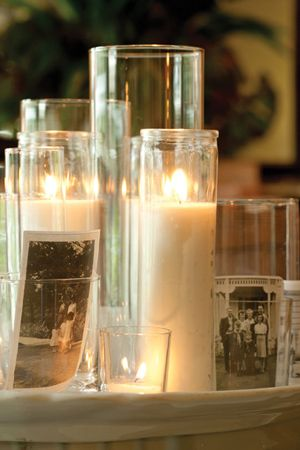 Glass, white candles and vintage black and white photos make an elegant and meaningful centerpiece. - from The Cottage Journal