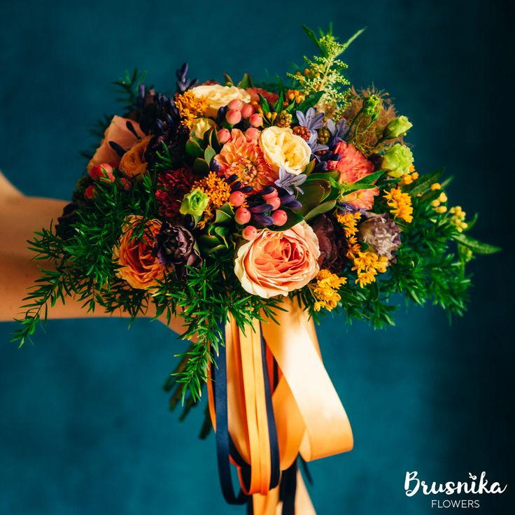 Bridal orange bouquet of garden roses, agapanthus, hipericum, rubus, spray roses, eustoma, dahlia, asclepia, cotinus