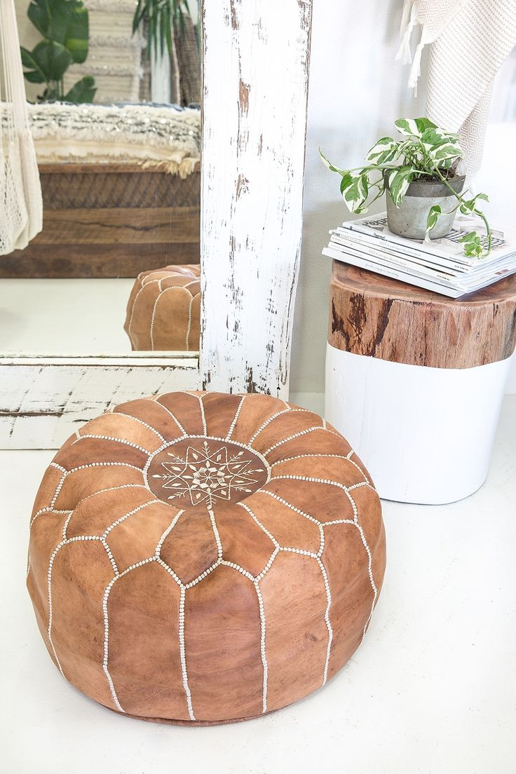 Give your room a dash of style with the Moroccan Pouf Ottoman. It is available in many beautiful colors to choose from. The round hand-made pouf is made from goatskin leather that enhances its strengt