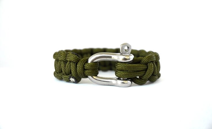 Camo Green 483 // Paracord Survival Bracelet |  Is chosen by an individual looking for a versatile piece. The colour is from our Utilitarian collection of colours and retains an understated level of class. It is both acceptable in the field and everyday at work. Camo Green 483 is for the tactical enthusiast seeking a statement piece for their daily life.  This Olive Green emanates a grounded sense of elegance and is ideal for the field in any situation.  #Paracord #FunctioningWithStyle