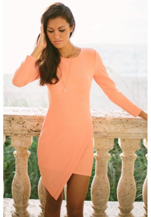 Look stunning in our Ashlyn coral bodycon! Long sleeve textured asymmetrical dress