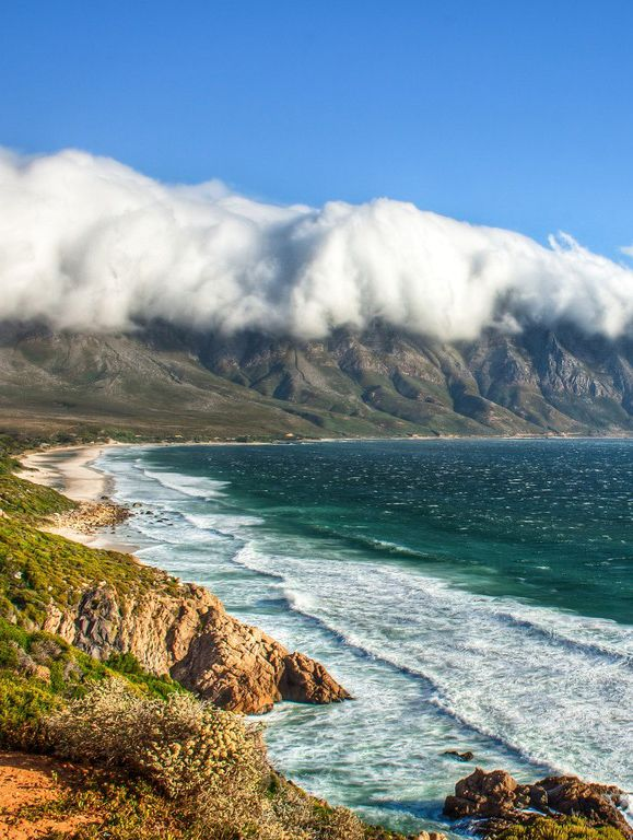 Turquoise waters meet the sandy shore at Kogel Bay Resort, South Africa.
