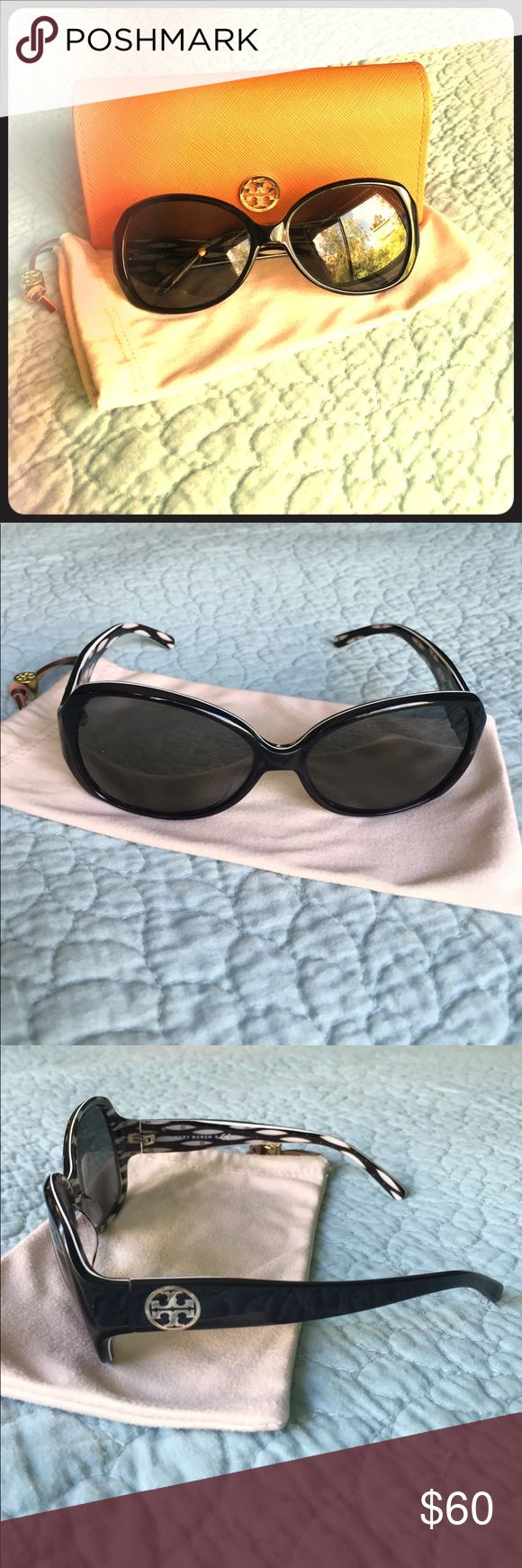 Tory Burch Sunglasses 🕶 Chic black Tory Burch sunglasses with cream microfiber pouch and orange case. Tory Burch emblem on temple of sunglasses, front of case, and leather string of pouch. Black, cream, and beige design on inside of sunglasses with middle white piping all around. Needs non-prescription lenses. Tory Burch Accessories Sunglasses