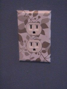 Cover wall outlets with scrapbook paper.