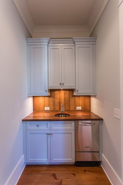 builtin wet bar alcove with blue shaker cabinets adorned with round nickel cabinet pulls - Wet Bar Cabinets
