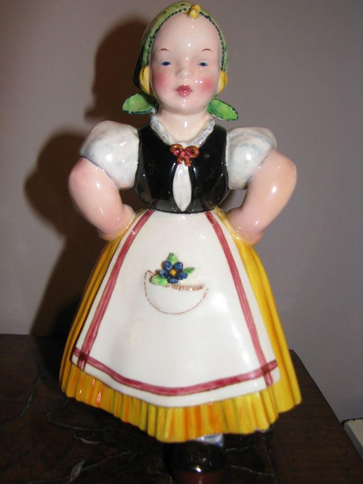 Ceramica olandesina di Tarcisio Tosin La Freccia  Deliziosa ceramica policroma raffigurante una giovane olandesina. Reca il marchio FS con la freccia. Manifattura Tarcisio Tosin – La Freccia. Vicenza, anni 30 del Novecento.