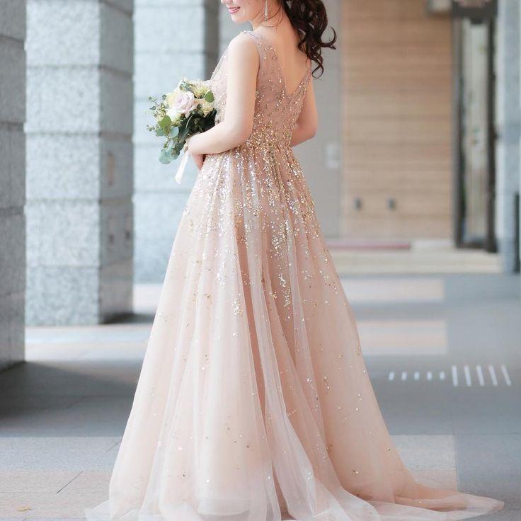 カラードレスは憧れの @reem_acra のもの。 . . 動く度にきらきらする本当に素敵なドレス�� 嬉しくて終始にやにやしてしまいました☺️ . . __________________ #thetreatdressing#reemacra#dress#wedding#instawedding #weddingdress#トリートドレッシング #リームアクラ http://gelinshop.com/ipost/1523188104026212595/?code=BUjc4KqlUjz