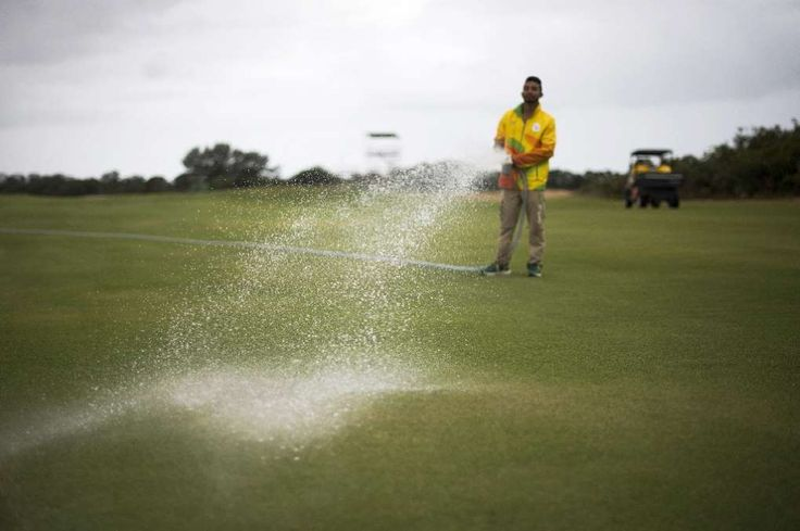 Village athletes welcome US golf millionaires  -  August 10, 2016  -      A groundsman waters a fairway on the Rio Olympic golf course