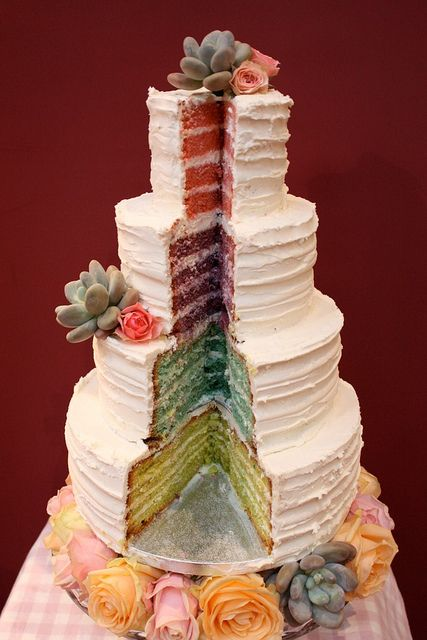 White icing on the outside with colorful sponges for each layer in the inside