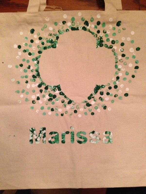 Girl Scout bags: Our girls made bags for their GS stuff (binder, sash/vest, etc.). One of the parents used a printer/cutter to cut stencils then we spray glued them on. Then the girls mixed green and white paint to get the shades they wanted. They painted on the dots using the eraser-end of a pencil. Make sure to put cardboard inside first. Let dry overnight and carefully peel away the stencil. by leann