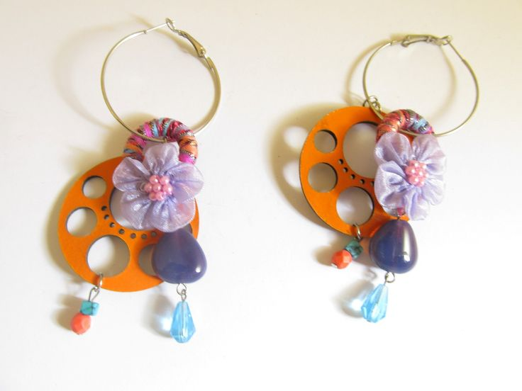 Handmade laser cut leather earrings (1 pair)  Made with orange leather filigree, silver tone antiallergic earring hoops, fiber hoop, fabric flower and glass beads.