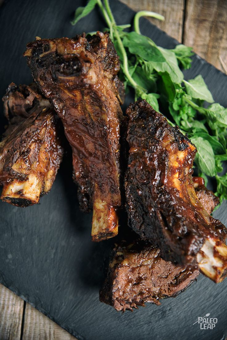 ... baked beef ribs brushed with a thick layer of Paleo-friendly BBQ sauce