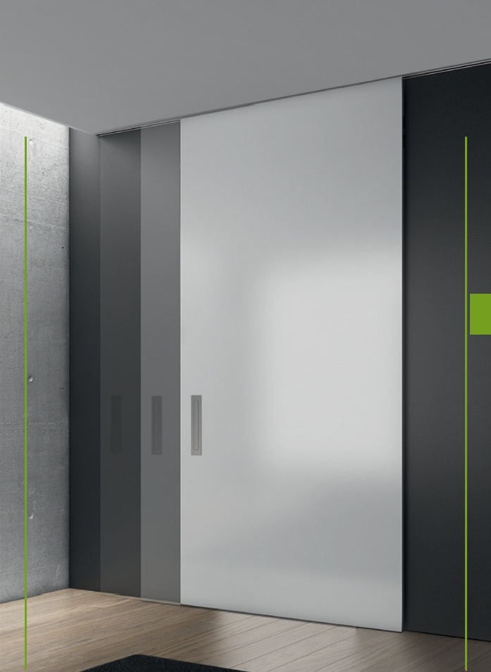 FLUSH KIT Sliding kit specially created to be embedded in plasterboard false ceiling. For glass or wooden sliding doors, Lean spaces collection of flush door brackets allow an almost full height leaf to be used, bringing the door head into closer proximity with e.g. the ceiling, essentially only a shadow gap is left between the leaf and the track assembly.