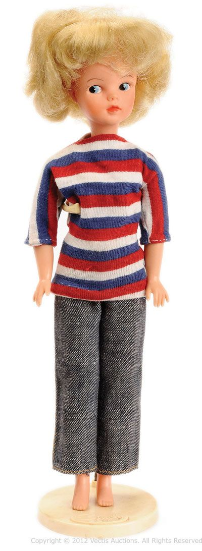 """11.5"""" vinyl first issue blonde Sindy doll, in original fashion with stand, United Kingdom, 1963, by Pedigree Toys."""