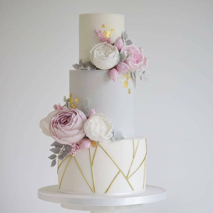 Geometric cake with flowers.