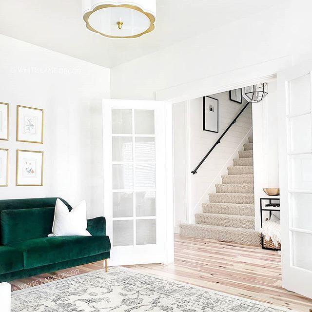 Whitelanedecor Whitelanedecor Font Room Off Entry With Glass Pane Windows Neutral Floral Rug With Green Velvet Sofa Gold Front Room House Styles Green Sofa