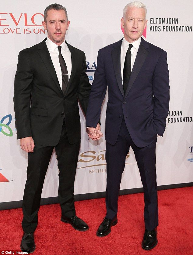 Hot off the press: Macho newsman Anderson Cooper was there with partnerBenjamin Maisani