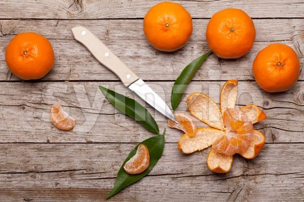 Stock photo of Honey Tangerines On Wood Table from $1.99. Still life with honey tangerines on wood table....