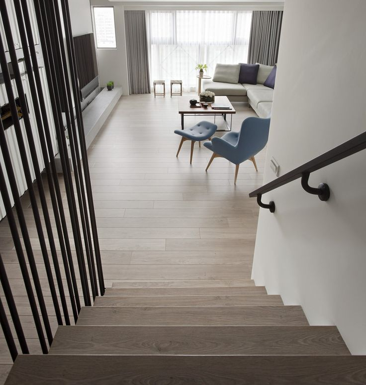 http://boomzer.com/two-apartment-minimalist-asian-designs/modern-staircase-with-iron-railing-fertility-design-1424-square-feet-132-square-meters-huang-yi-feng-li-yuzhi-light-wood-floor-blue-chair-glass-window-gray-curtains/