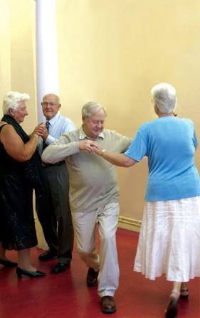 Older couple dancing.