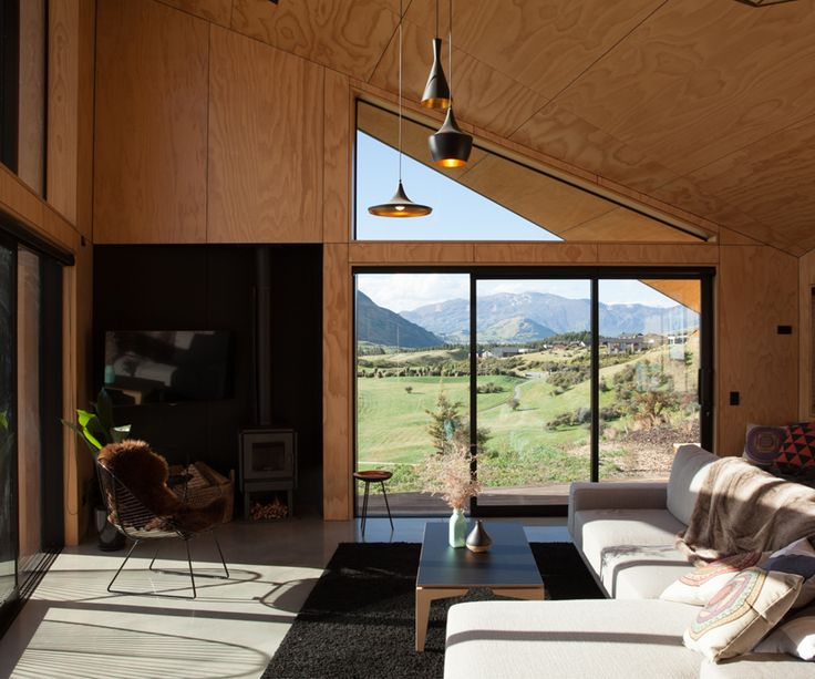 The home's living area is lined in plywood and has carefully framed views north and west.