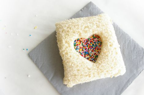 fairy bread recipe - fun for the children's lunch on valentine's day (2 slices of bread, pb, honey, sprinkles)