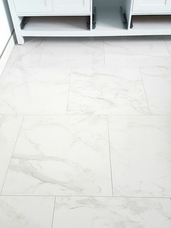 Choosing Faux Carrara Marble Floor Tile For The Bathroom Marble Tile Floor Marble Tile Bathroom Carrara Marble Floor