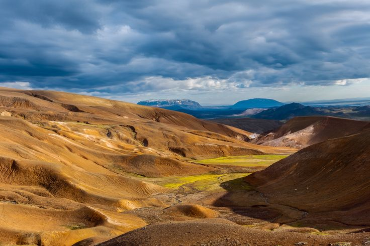 A lush valley between volcanic hills near the Viki crater in spectacular countryside near Myvatn Lake in Northern Iceland.